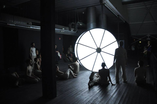 Gabriel beck, Exhumeia, film, Installation in-situ, choregraphy louise kalfon, sound aymeric de tapol vidéo HD, wheel light (aluminium, polycarbonate, led), sound in the wheel and performance for 10 dancers. 2013, Production Studio National des Arts Contemporains du Fresnoy